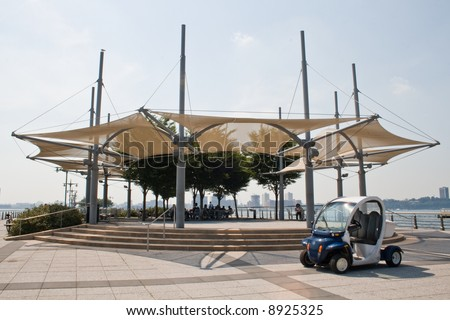 Electromobile on the pier. Pier with a recreation area. Awning shed. - stock photo