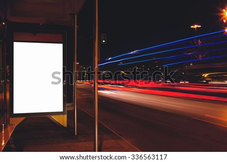 Electronic advertising board with copy space screen for your text message or content, empty banner in urban setting, clear poster with night light on background, public information billboard outdoors  - stock photo