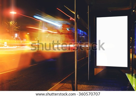 Electronic blank billboard with copy space for your text message or promotional content, clear public information board in night city with cars's movement on background, bus stop advertising mock up  - stock photo