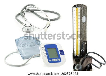 Electronic blood pressure with stethoscope medical equipment isolated on white - stock photo