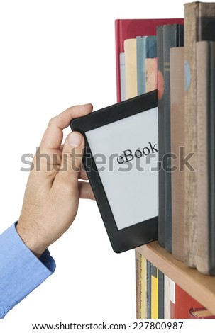 Electronic book picked from a library shelf - stock photo