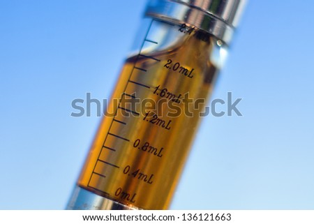 Electronic cigarette container tube with measures. Macro close up. - stock photo