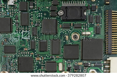 Electronic circuit computer board with chips and processors - stock photo