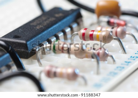 electronic circuit testing on bread board - stock photo