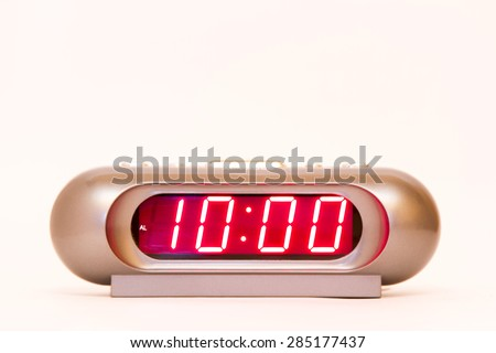 electronic clock alarm clock with red illumination and the time 10:00 - stock photo