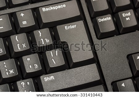 Electronic collection - close-up black computer keyboard with russian letter and key enter - stock photo