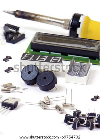 Electronic components and soldering iron isolated on white background - stock photo