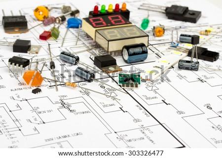 Electronic components, electronic diagram,  transistors, integrated circuits, capacitors, resistors, LED - stock photo