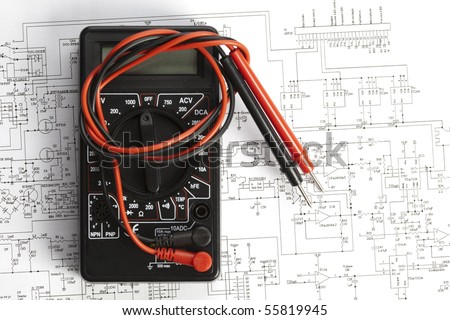 Electronic components on a schematic diagram background. - stock photo