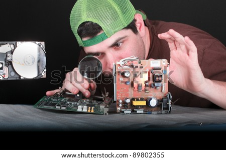 Electronic engineer solving problems - stock photo