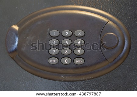 Electronic home safe keypad, Small home or hotel wall safe with keypad, closed door. - stock photo