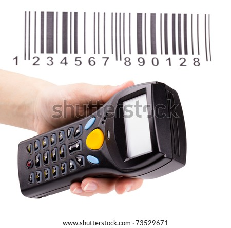 Electronic manual scanner of bar codes in woman hand - stock photo