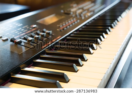 Electronic musical keyboard synthesizer close-up - stock photo