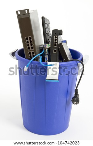 electronic scrap in trash can. keyboard, cables, logic board, hard drive - isolated on white background - stock photo