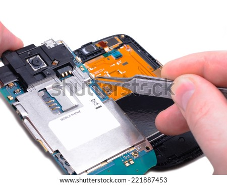 Electronic technician operates with mobile phone circuit board at electronic lab working place.Close-up with Shallow DOF. Isolated on white background.  - stock photo
