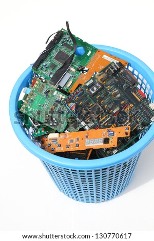 Electronic waste in basket - stock photo