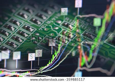 electronics circuit with stock chart - stock photo
