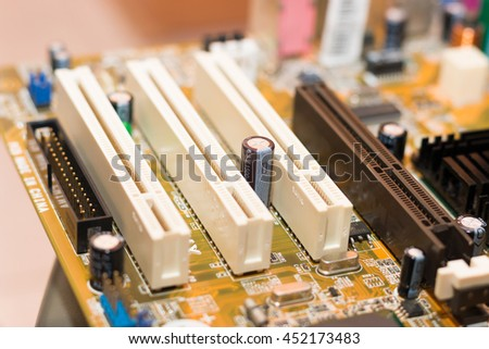 Electronics components on modern PC computer mainboard - stock photo