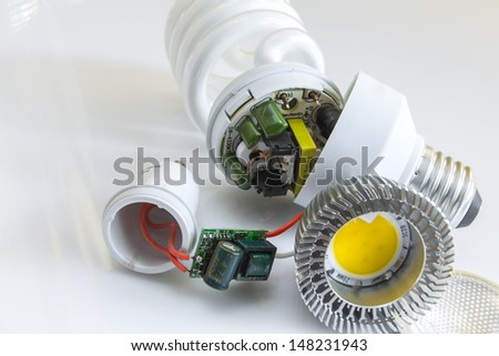 electronics in the various GU10 LED bulbs and compact fluorescent lamps E27,  CFL - stock photo