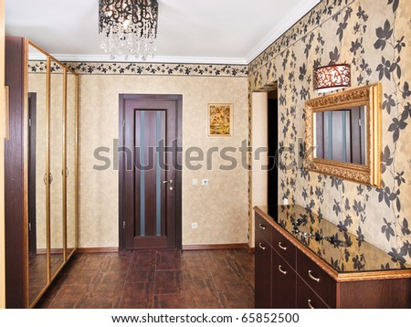 Elegance anteroom interior in warm tones with hall-stand and mirror - stock photo