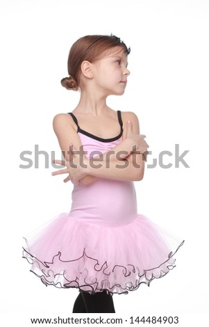 Elegance dancer in a ballerina costume/Studio image of a charming dancer with beautiful hair in a pink tutu smiling and dancing on white background - stock photo