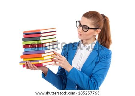Elegance female in black glasses holding stack of books. Waist up studio shot isolated on white. - stock photo