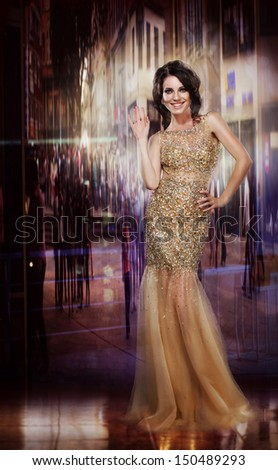 Elegance. Glamorous Glorious Lady in Yellow Dress. Formal Party - stock photo
