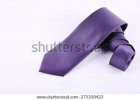 Elegance tie on wooden table background - stock photo