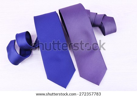 Elegance ties on wooden table background - stock photo