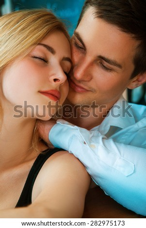 Elegance young couple in love huggin at bar. vertical photo - stock photo