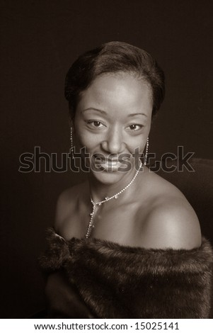 Elegant African American woman smiling in sepia tone - stock photo