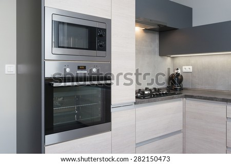 Elegant and comfortable kitchen interior - stock photo