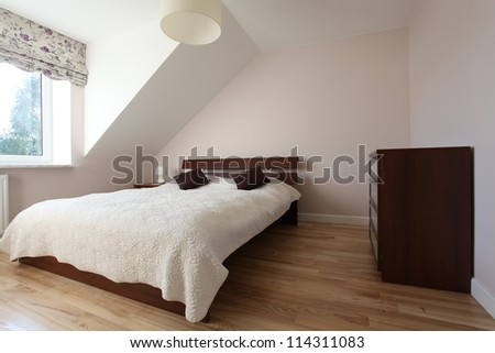 Elegant and cosy bedroom in modern house - stock photo