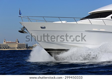 Elegant and graceful luxury power boat underway off Palm Beach, Florida - stock photo