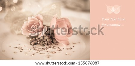 Elegant and romantic dinner setting with rose decoration and lights,copy space with leaf decoration - stock photo