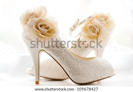 Elegant and stylish bridal shoes. - stock photo