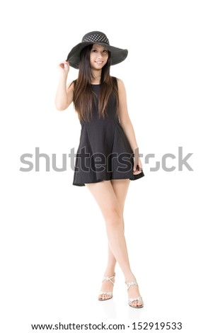 Elegant asian young lady in black dress with hat. Full length portrait. Isolated on the white background. - stock photo