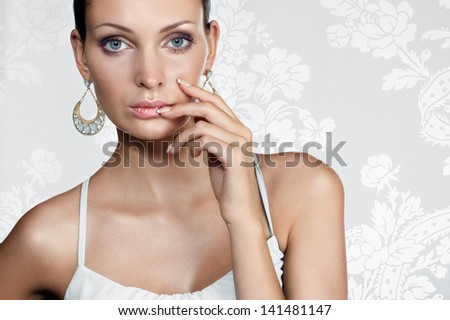 Elegant beautiful woman on white fancy background - stock photo