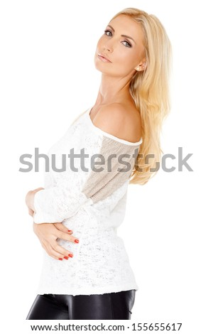 Elegant beautiful young woman with long blond hair and a lovely slender body posing sideways turning to look at the camera over her shoulder  isolated on white - stock photo