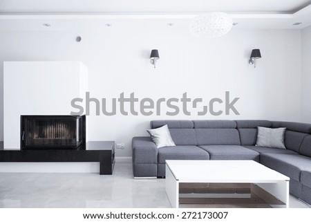 Elegant big lounge with grey comfortable corner sofa - stock photo
