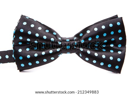 Elegant black bow tie in blue polka dots on an isolated white background - stock photo