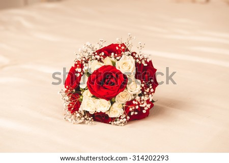 elegant bridal bouquet composed of red and white roses - stock photo