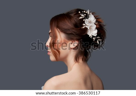 Elegant bride with brown short hair updo and bare shoulders white wedding dress - stock photo