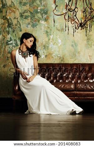 Elegant brunette woman posing - stock photo