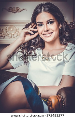 Elegant brunette woman, studio shot - stock photo