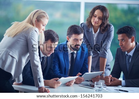 Elegant business partners planning work at meeting - stock photo
