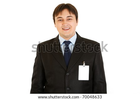 Elegant businessman with blank id card on  his jacket  isolated on white - stock photo