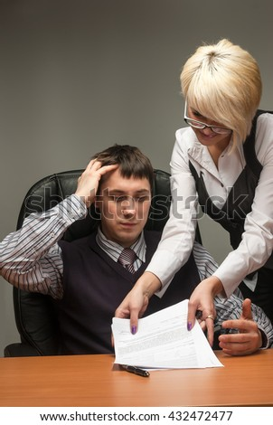 Elegant businesswoman bringing some documents to her boss - stock photo