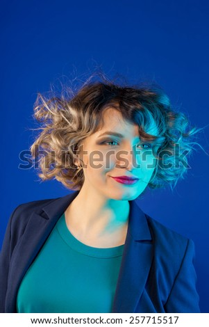 Elegant businesswoman. studio shot on blue background - stock photo