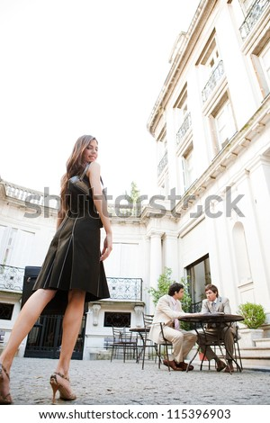 Elegant businesswoman walking to a meeting in a luxury building coffee shop terrace, outdoors. - stock photo